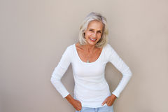Beautiful older woman standing and smiling. Portrait of beautiful older woman standing and smiling Stock Photos