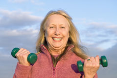 Beautiful older woman working out. stock photography