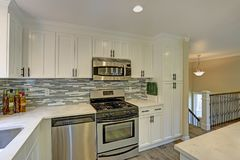 Beautiful open plan second floor white kitchen Royalty Free Stock Images