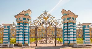Beautiful openwork gates. Are decorated with golden double-headed eagle - symbol of the Russian Empire Stock Photo