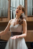 Beautiful opera singer sings Stock Images