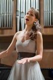 Beautiful opera singer sings Stock Images