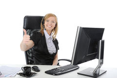 Beautiful operator smiling at the computer Stock Photo