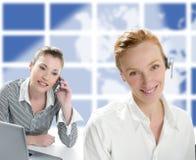 Beautiful operator women smiling and talking phone. Beautiful headphones operator women smiling and talking phone Royalty Free Stock Photo