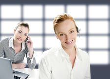 Beautiful operator women smiling and talking phone Royalty Free Stock Images