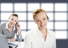 Beautiful operator women smiling and talking phone. Beautiful headphones operator women smiling and talking phone Royalty Free Stock Images