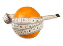 Beautiful orange. Orange with measuring tape isolated on white Royalty Free Stock Images