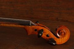 Beautiful antique violin on brown wood background royalty free stock images