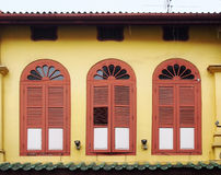 Beautiful orange arch window with yellow wall Royalty Free Stock Images