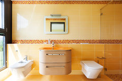 Beautiful orange bathroom Stock Photo