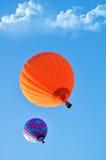 Beautiful orange and blue hot air balloon. Beautiful scene with hot air balloons in the blue sky Stock Photo