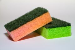 beautiful orange and green scouring sponges royalty free stock photos