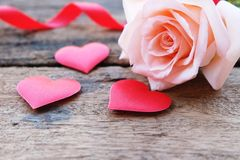 Beautiful Orange-Pink rose and deep red satin heart for Valentine& x27;s backdrop royalty free stock photo