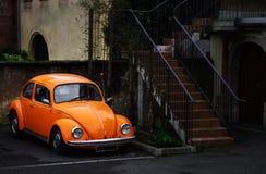 Beautiful orange retro car on the street Stock Image