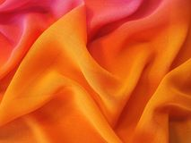 Beautiful orange silk fabric texture Stock Images