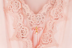 Beautiful orange silk sleepwear and robes. Satin nightgown Stock Photos