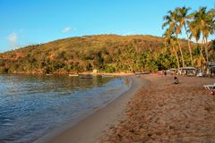 Beautiful orange sunlite beach with some boats Royalty Free Stock Image