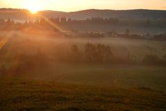 Beautiful orange sunrise and fog Royalty Free Stock Photography
