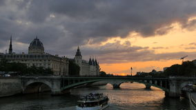 Seine river in Paris at sunset orange sun. Beautiful orange sunset over the waters of the Seine River crossing Paris city center stock video