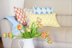 Beautiful orange tulips bouquet on wooden table in the living ro Royalty Free Stock Images