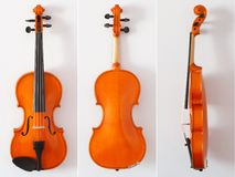 Beautiful orange violin from all sides on white background royalty free stock photo