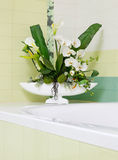 Beautiful orchid flower decor in bathroom design Royalty Free Stock Image