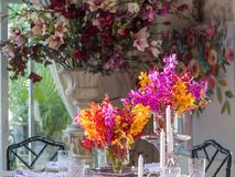 Beautiful orchid vase on the dining table. stock image