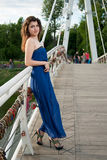 Beautiful oriental girl on bridge over the river Royalty Free Stock Photos