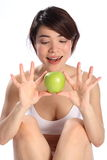 Beautiful oriental girl holding green apple fruit Royalty Free Stock Image