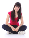 Beautiful oriental teenager girl cross legged Royalty Free Stock Images