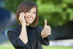 Beautiful Oriental Woman On A Cell Phone Stock Photography