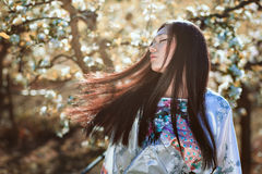 Beautiful oriental woman with long hair. Outdoor portrait Stock Photos