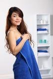 Beautiful oriental woman wearing blue bath towel Royalty Free Stock Photography