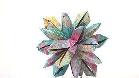 Beautiful origami patterned flower. Floral origami decoration isolated on white background. Beauty of paper folding royalty free illustration