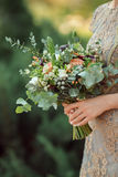 Beautiful original wedding bouquet in the bride hands Royalty Free Stock Photos