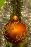 Beautiful ornament hanging on a Christmas tree royalty free stock photos