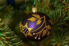 Beautiful ornament hanging on a Christmas tree royalty free stock photography