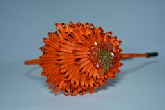 A beautiful ornament of an orange thin ribbon with stones and a metal chain in the form and in the style of a peacock stock image