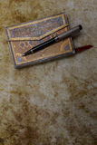 Beautiful ornamented old diary and pen Royalty Free Stock Photos