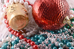 Beautiful ornaments, champagne, pearl and balls as a New Year decoration Royalty Free Stock Photos
