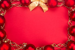 Beautiful ornaments framed Christmas decoration in red backgroun Stock Photo