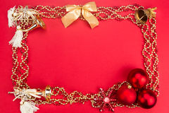 Beautiful ornaments framed Christmas decoration in red backgroun Stock Photography