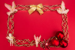 Beautiful ornaments framed Christmas decoration in red backgroun Royalty Free Stock Photos