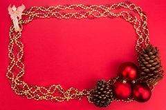 Beautiful ornaments framed Christmas decoration in red backgroun Stock Photos