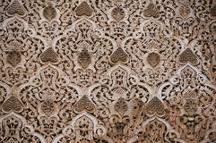 Beautiful ornate carving on the plastered walls in the courtyard Royalty Free Stock Photo