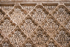 Beautiful ornate carving on the plastered walls in the courtyard Stock Image