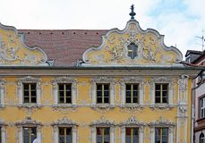 Ornate house facade in germany. Beautiful ornate design in detail on a house façade in Germany royalty free stock image