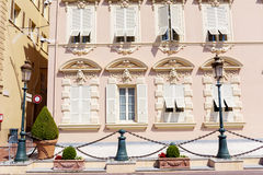 Beautiful ornate pink building with old french shutter windows in  Monaco, Monte Carlo. Stock Photography