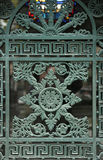 Beautiful ornate tomb door in the Pere Lachaise cemetery. Paris Stock Photos