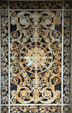 Beautiful ornate tomb door in the Pere Lachaise cemetery. Paris Royalty Free Stock Photography